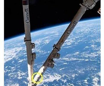 Space Station Canadarm2 Robotic Arm Gets Hit By Orbital Junk